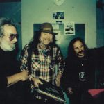 "Jerry Garcia, Glenn Allen Howard and Steve Brown New Year's Eve, 1992. Glenn is holding a few of a large stack of Ken Nordine records moments before we all crashed David Gans' NYE broadcast with the voice of ""Word Jazz,"" along with Lord Buckley, the greatest jazz poet of all time. As Jerry, Bob Weir, Dan Healy, Steve and Glenn testified as to his influence, he was moved to tears. Ken had no idea that he had been a major influence on the Dead and the Bay Area Hip scene of the late 50s and 60s. Randy Wood of Dot records, signed Nordine for the Dot label (home of Lawrence Welk and Pat Boone, to give you an idea how edgy they were, ) soley because Fred Astaire said he loved him, and Wood claimed his records didn't ever sell. Randy Wood is also in the Hall of Shame for physically destroying most copies of a Jack Kerouac album released on Dot when he found out what it was."